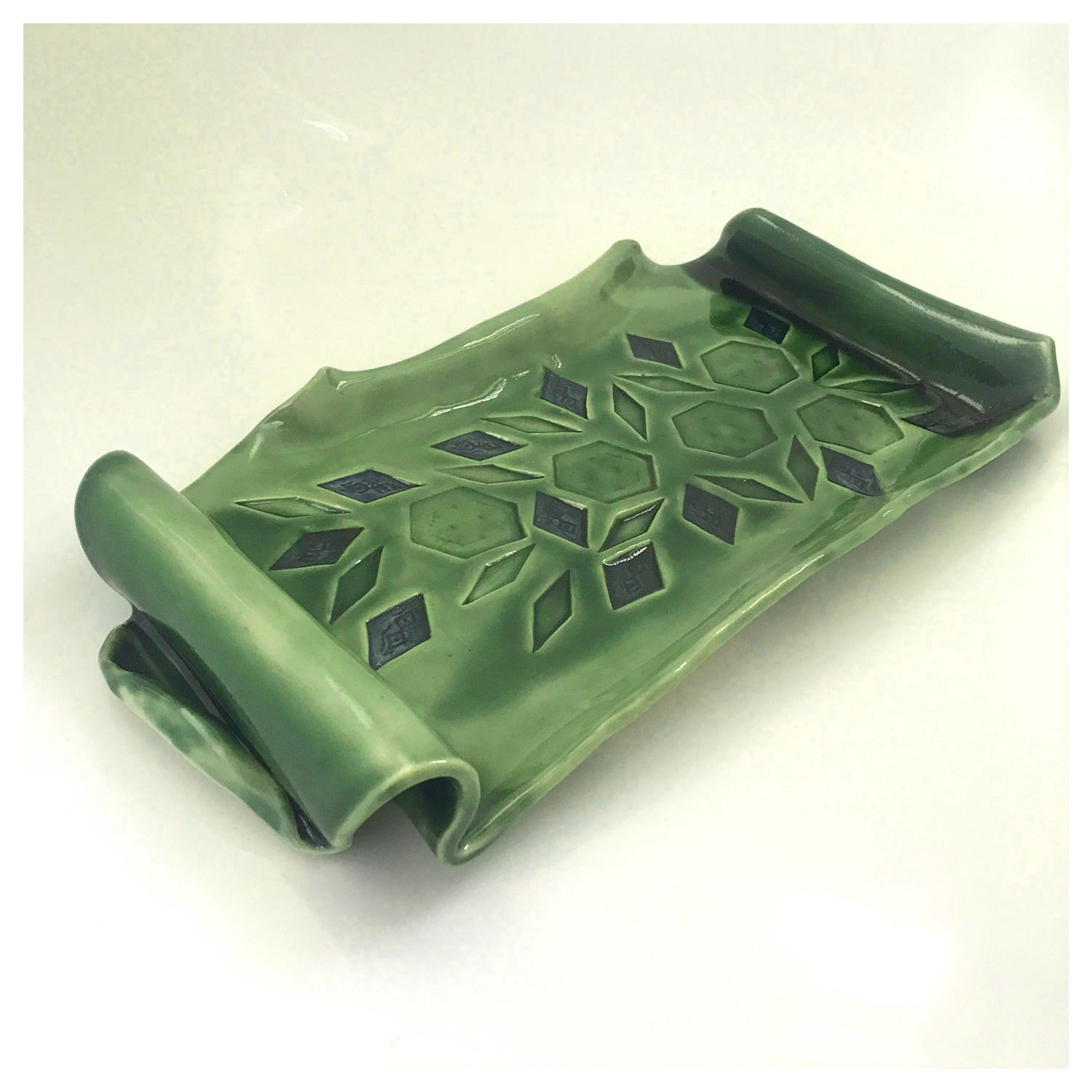 Nicole Lyster Green Ceramic Serving Plate Stoneware 350x230mm £50 This Shiny Green Glazed Ceramic Plate in the shape of a Scroll is for serving those Party Sandwiches and Cakes to set off your dining table with festive Fun